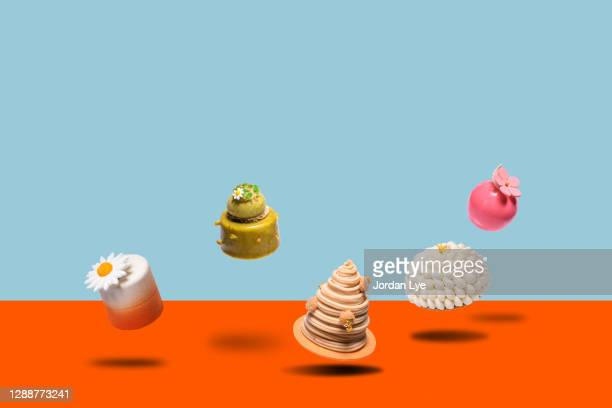 desserts cakes floating in mid air - cake stock pictures, royalty-free photos & images