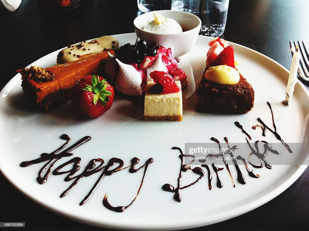 Desserts In Plate With Happy Birthday Written With Chocolate Sauce : Stock Photo