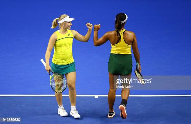Destanee Aiava and Daria Gavrilova of Australia celebrate a point in the doubles match against Lesley Kerkhove and Demi Schuurs of the Netherlands...