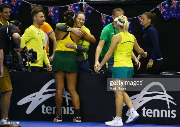 Destanee Aiava and Daria Gavrilova of Australia celebrate with team mates after winning the doubles match against Lesley Kerkhove and Demi Schuurs of...