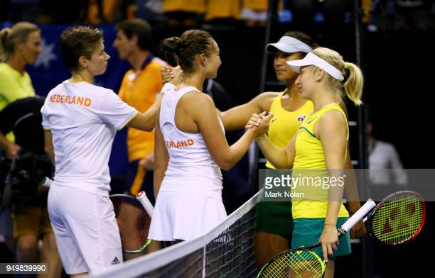 Destanee Aiava and Daria Gavrilova of Australia shake hands with Lesley Kerkhove and Demi Schuurs of the Netherlands after the doubles match during...