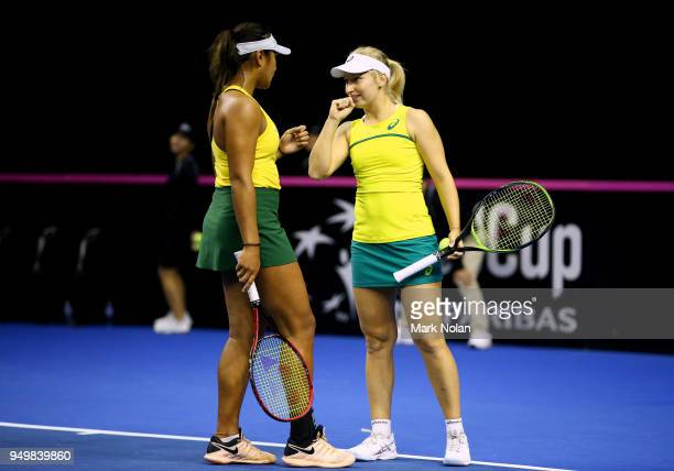 Destanee Aiava and Daria Gavrilova of Australia talk in the doubles match against Lesley Kerkhove and Demi Schuurs of the Netherlands during the...