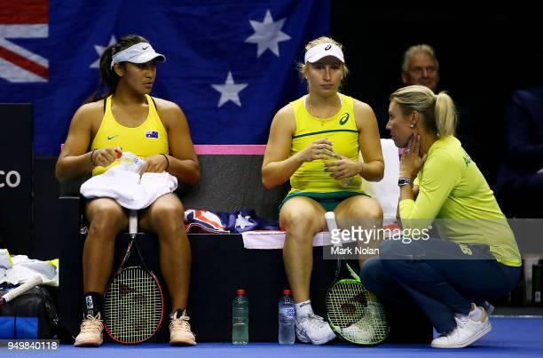 Destanee Aiava and Daria Gavrilova of Australia talk with Australian captain Alicia Molik during the doubles match against Lesley Kerkhove and Demi...