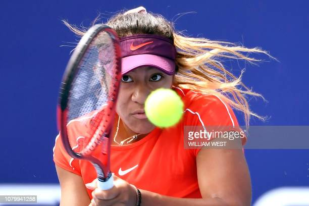 TOPSHOT Destanee Aiava of Australia hits a backhand return to Sorana Cirstea of Romania on the final day of the Kooyong Classic tennis tournament in...