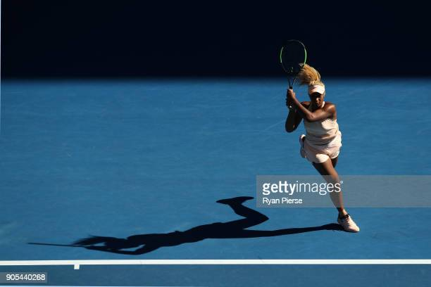 Destanee Aiava of Australia plays a backhand in her first round match against Simona Halep of Romania on day two of the 2018 Australian Open at...