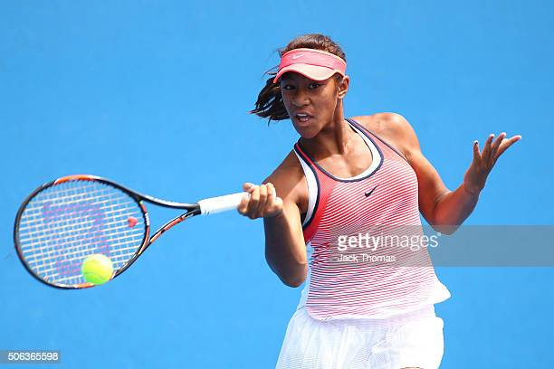 Destanee Aiava of Australia plays a backhand in her first round juniors match against Xiyu Wang of China during the Australian Open 2016 Junior...