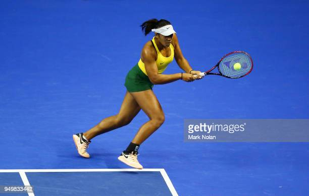Destanee Aiava of Australia plays a backhand in hermatch with Daria Gavrilova of Australia against Lesley Kerkhove and Demi Schuurs of the...