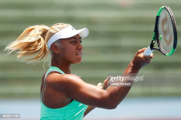 Destanee Aiava of Australia plays a forehand against Eugenie Bouchard of Canada during day three of the 2018 Kooyong Classic at Kooyong on January 11...