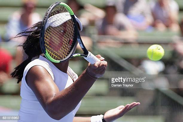 Destanee Aiava of Australia plays a forehand shot in her match against Qiang Wang of China during day three of the 2017 Priceline Pharmacy Classic at...
