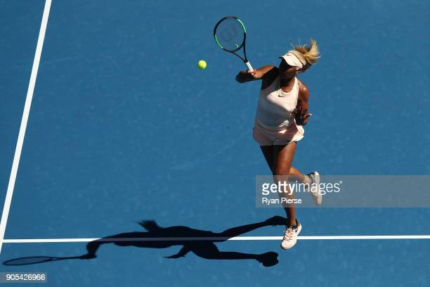 Destanee Aiava of Australia plays a forehand smash in her first round match against Simona Halep of Romania on day two of the 2018 Australian Open at...