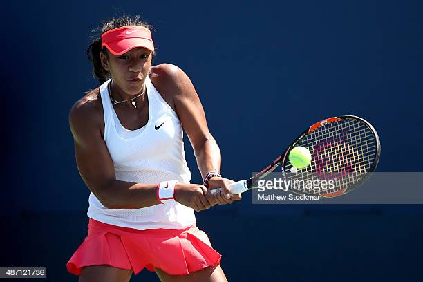 Destanee Aiava of Australia returns a shot to Wushuang Zheng of China during their Junior Girls' Singles First Round match on Day Seven of the 2015...