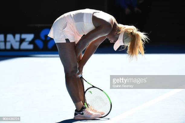 Destanee Aiava of Australia struggles between points in her first round match against Simona Halep of Romania on day two of the 2018 Australian Open...