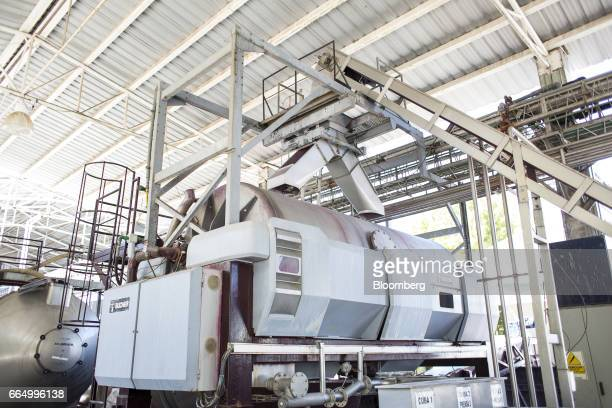 A destemmer machine stands at the Bodega Santa Julia production facility in Mendoza Argentina on Tuesday March 23 2017 The Argentine wine industry is...