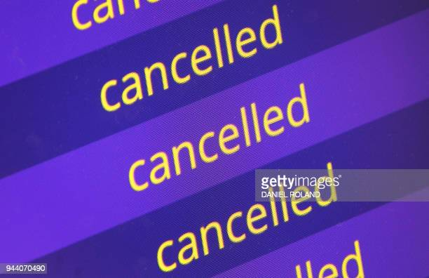A destination board displays cancelled flights at the airport in Frankfurt am Main Germany on April 10 2018 as 'warning strikes' by German public...