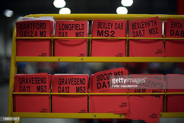Destination cards are displayed in a rack at Royal Mail's Medway Sorting Centre on December 18 2012 in Rochester England The recently opened £70...