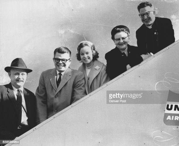 Honolulu Denver Post columnist Jack Guinn stands on the loading ramp of a United Airliner with two finalists and their guests en route to the Kaiser...