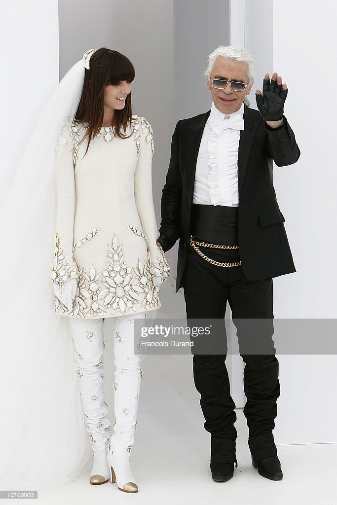 Destinger Karl Lagerfeld and one of his models are seen on the runway at the end of his Chanel Haute Couture Fall-Winter 2006/07 Fashion show during Paris Fashion Week at Pelouse de St Cloud on July 6, 2006 in Paris, France.