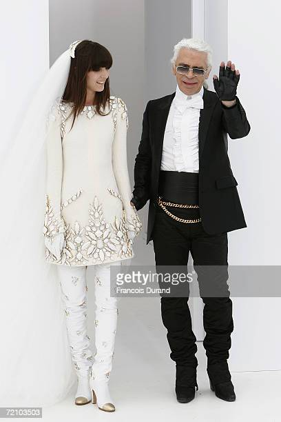 Destinger Karl Lagerfeld and one of his models are seen on the runway at the end of his Chanel Haute Couture FallWinter 2006/07 Fashion show during...