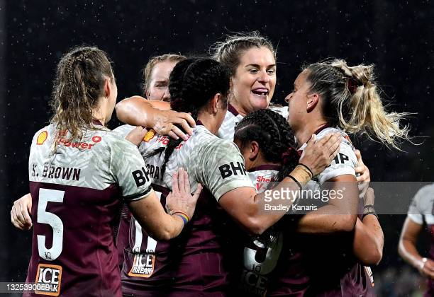 Destiny Brill of Queensland is congratulated by team mates after scoring a try during the Women's Rugby League State of Origin match at the Sunshine...