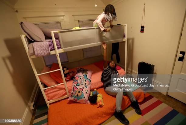 Destiny Johnson bottom and her sister Demi Johnson the daughter of Moms 4 Housing's Misty Cross spend time in their room in a vacant house in West...