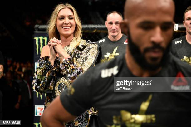 Destiny Johnson wife of Demetrious Johnson celebrates after her husband's submission victory over Ray Borg in their UFC flyweight championship bout...