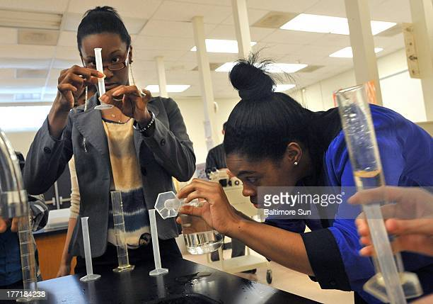 Destiny Miller left and Tamara James conduct a lab test in an Advanced Placement Biology class at Woodlawn High School in Woodlawn Maryland in April...