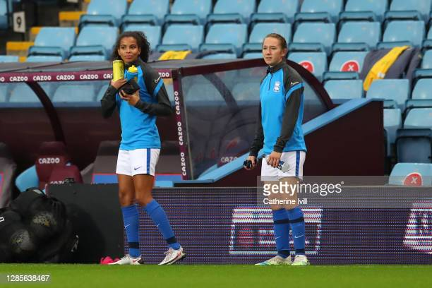 Destiny Toussaint and Lucy Whipp of Birmingham look on from the sidelines during the Barclays FA Women's Super League match between Aston Villa Women...