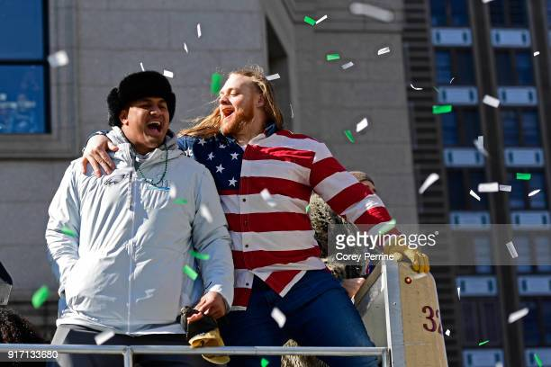 Destiny Vaeao and Beau Allen of the Philadelphia Eagles celebrate with Allen adorned in his flag shirt during festivities on February 8 2018 in...