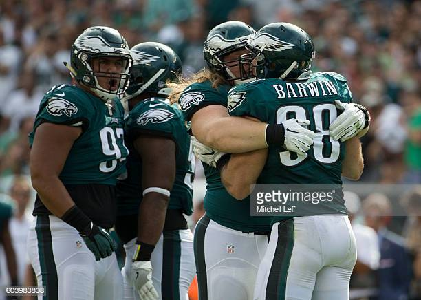 Destiny Vaeao, Beau Allen, and Connor Barwin of the Philadelphia Eagles celebrate against the Cleveland Browns at Lincoln Financial Field on...