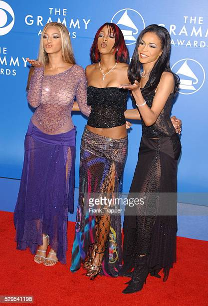 Destiny's Child blow kisses as they arrive at the 44th annual Grammy Awards