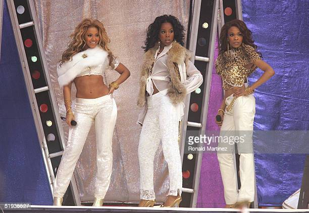 Destiny's Child members Beyonce Knowles Kelly Rowland and Michelle Williams perform during halftime of the game between the Dallas Cowboys and the...