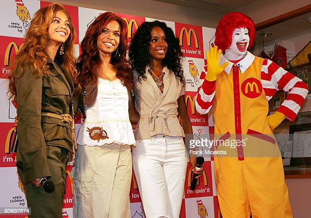 Destinys Child members Beyonce Knowles Kelly Rowland and Michelle Williams pose for photographers during their visit to the Ronald McDonald House...