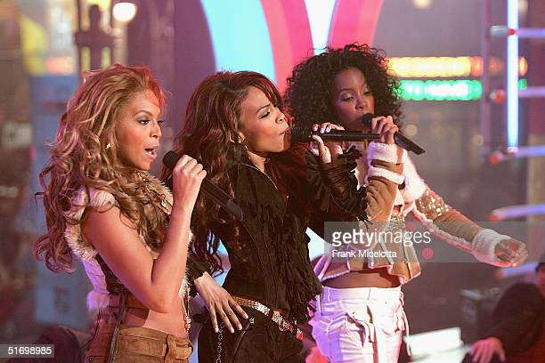 Destiny's Child members Beyonce Knowles Michelle Williams and Kelly Rowland appear on stage during MTV's Total Request Live at the MTV Times Square...