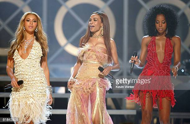Destiny's Child Members Beyonce Knowles Michelle Williams and Kelly Rowland perform onstage during the 2004 Billboard Music Awards at the MGM Grand...
