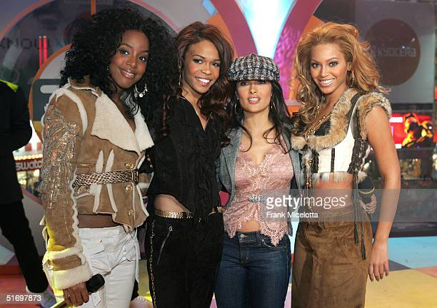 Destiny's Child members Kelly Rowland Michelle Williams actress Salma Hayek and Beyonce Knowles appear on stage during MTV's Total Request Live at...