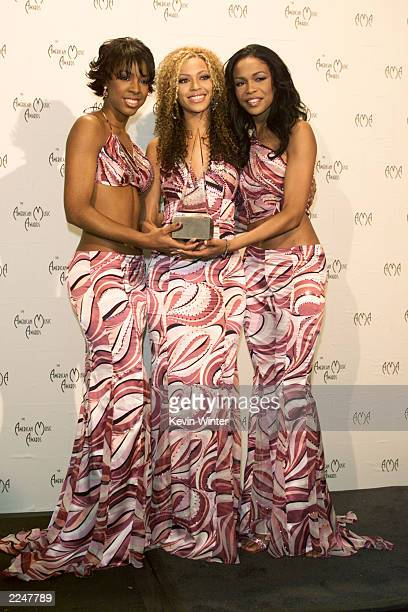 Destiny's Child poses backstage with award at the 28th Annual American Music Awards at the Shrine Auditorium in Los Angeles Monday Jan 8 2001 Photo...