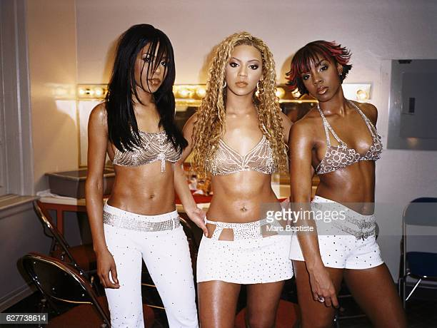 Destiny's Child poses in a dressing room Left to right Michelle Williams Beyonce Knowles and Kelly Rowland