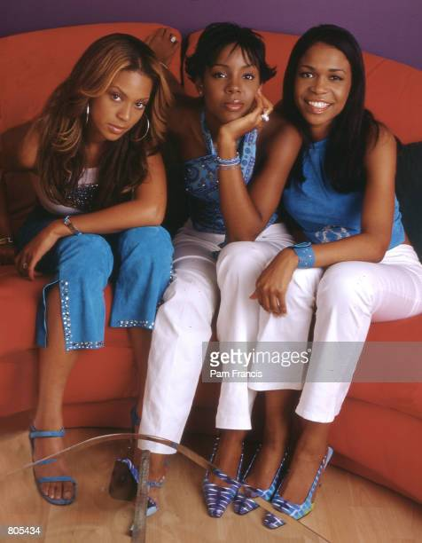 Destiny's Child poses on a couch in Beyonce's house May 20 2000 in Houston TX are Destiny's Child is from left to right Beyonce Knolls Kelly Rowland...