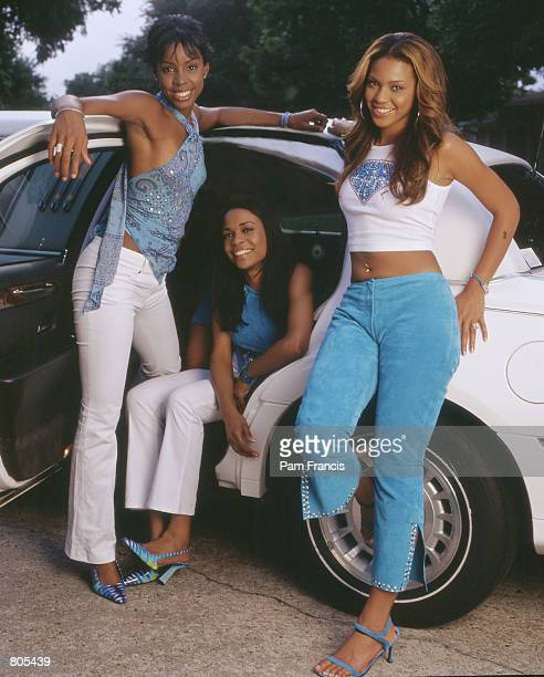 Destiny's Child poses outside Beyonce's house May 20 2000 in Houston TX Destiny's Child is from left to right Kelly Rowland Beyonce Knolls and...