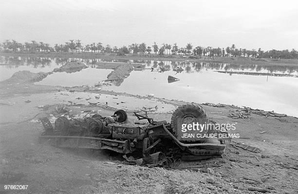 A destroyed army truck lay in the swamp near the Iraqi city of alHoweizah north of Basra 22 March 1985 after a fierce battle opposed Iraqi and...