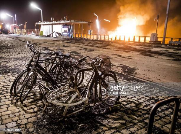Destroyed bicycles are pictured after a New Years Eve beach bonfire went out of control in Scheveningen a coastal resort near the Hague on January 1...