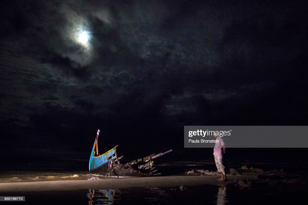 A destroyed boat is seen on a beach washed up after it sunk in rough seas off the coast of Bangladesh carrying over 100 people September 28 close to Patuwartek, Inani beach, Bangladesh. Seventeen survivors were found along with the bodies of 15 women and children. Over 500 Rohingya refugees have fled into Bangladesh since late August during the outbreak of violence in Rakhine state as Myanmar's de facto leader Aung San Suu Kyi downplayed the crisis during a speech in Myanmar this week faces and defended the security forces while criticism on her handling of the Rohingya crisis grows. Bangladesh's prime minister, Sheikh Hasina, spoke at the United Nations General Assembly last week, focusing on the humanitarian challenges of hosting the minority Muslim group who currently lack food, medical services, and toilets, while new satellite images from Myanmar's Rakhine state continue to show smoke rising from Rohingya villages.