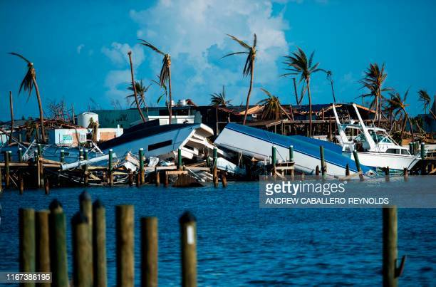 Destroyed boats are pushed up against the pier in the aftermath of Hurricane Dorian in Treasure Cay on Abaco island, Bahamas, on September 11, 2019.