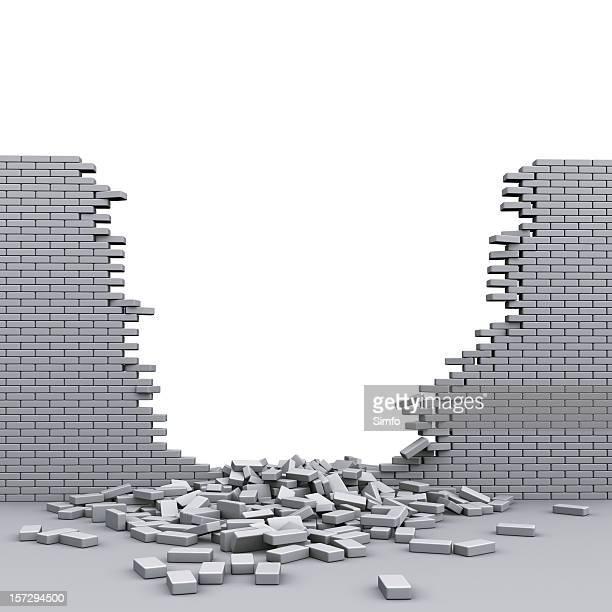 A destroyed brickwall with broken bricks