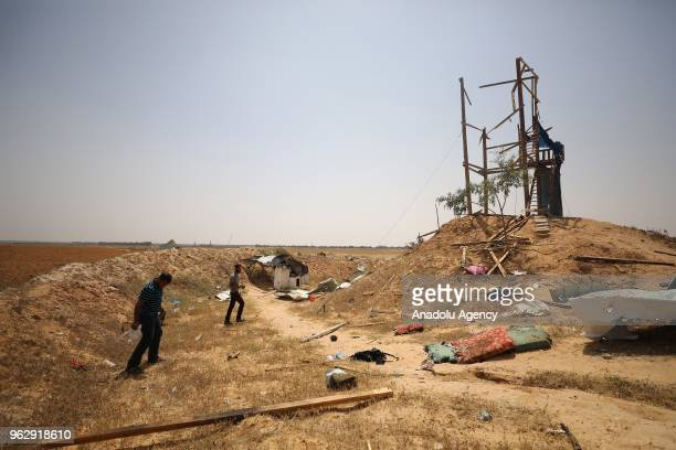 A destroyed building is seen after Israeli forces targeted a site affiliated with the Ezzedine alQassam Brigades the armed wing of resistance...