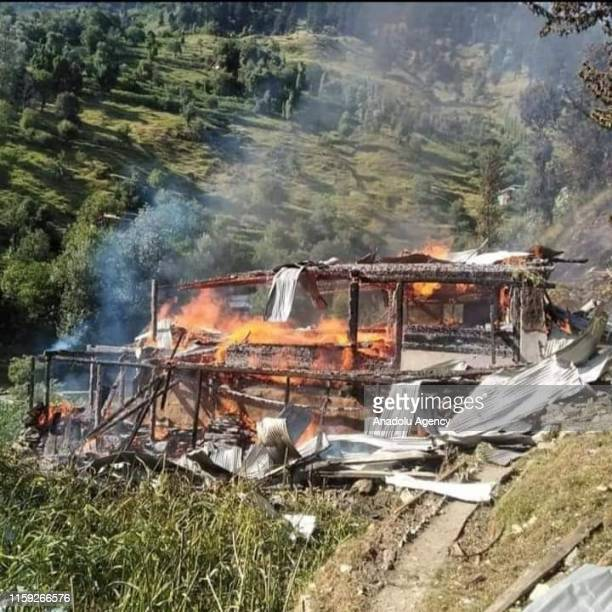 A destroyed building is seen on fire after Indian forces attacked near Line of Control in Pakistan on August 03 2019 Pakistan Army claims that Indian...