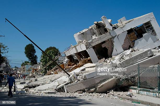 A destroyed building is seen on January 13 2010 in PortauPrince Haiti Planeloads of rescuers and relief supplies headed to Haiti as governments and...