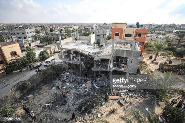 A destroyed building of a Palestinian family which was targeted in Israeli airstrikes is seen in Khan Yunis Gaza on November 14 2018 Israel also...