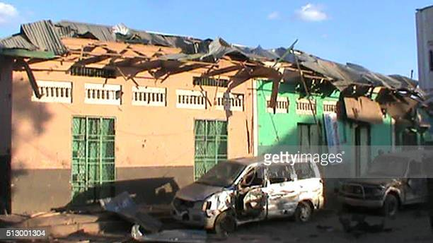Destroyed buildings and vehicles are seen on 28 February 2016 in Baidoa after twin explosions in the Somali city killed at least 30 people An initial...