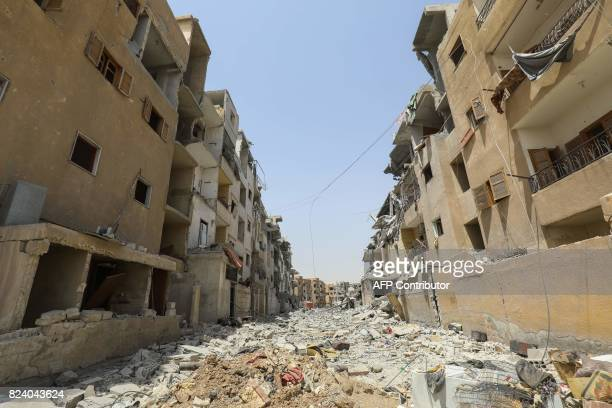 Destroyed buildings are pictured amid rubble in Raqa on July 28 2017 The Syrian Democratic Forces a USbacked KurdishArab alliance has ousted Islamic...